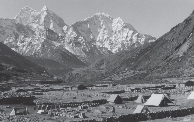 Judging from the number of plastic barrels stacked against the stone wall, this is most likely the Pheriche camp of the 1956 Swiss Everest expedition, where Fritz Müller was the expedition glaciologist (photograph by F. Müller).